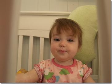 Clara through her crib bars