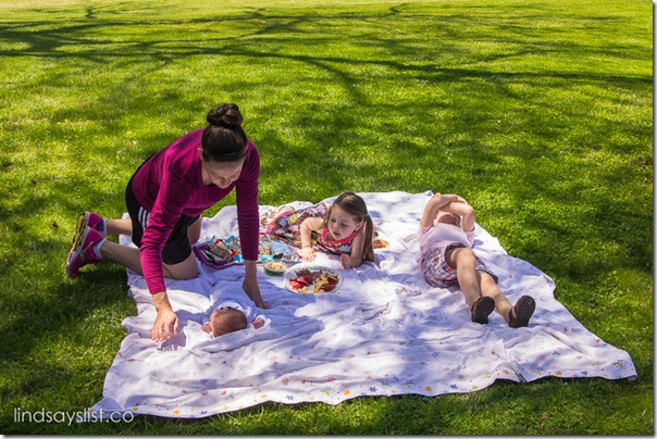 Family Laying on Picnic Blanket