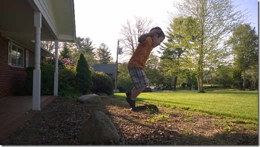 Boy Jumping In Mid Air